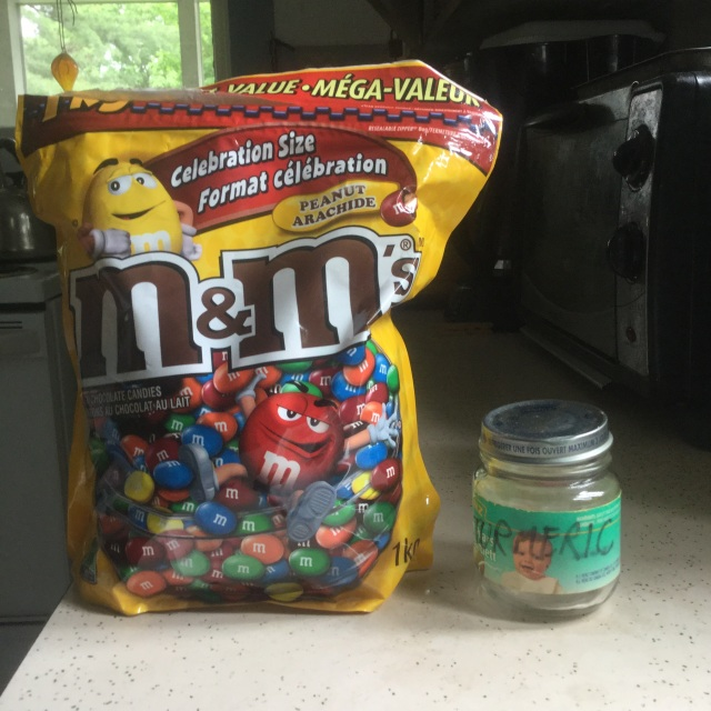 This is what a kilogram of M&Ms looks like (empty baby-food spice jar for scale)